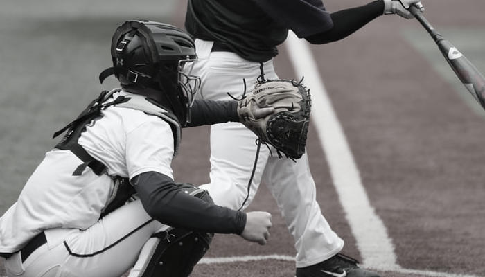 Why do Baseball players wear white pants