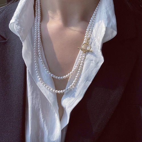 How To Wear A Long Necklace With A Collared Shirt