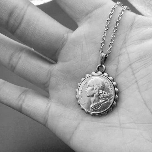 What Does A Coin Necklace Mean