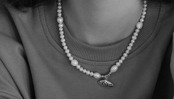 How to attach a pendant to a pearl Necklace